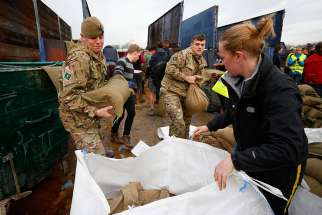 Local volunteers and the British Army fill sandbags Dec. 28 to stem floodwater in York, England. Pope Francis called on Christians to pray for victims of several natural disasters that have hit parts of the United States, Great Britain and Paraguay.