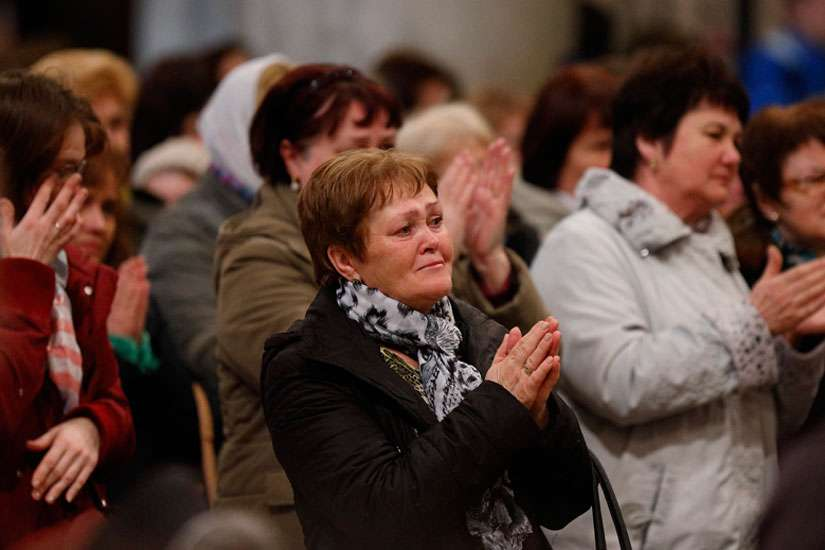 People react to a homily by Archbishop Sviatoslav Shevchuk of Kiev-Halych, leader of the Ukrainian Catholic Church, during a Divine Liturgy for Ukrainian expatriates at the Basilica of St. Mary Major in Rome Feb. 19