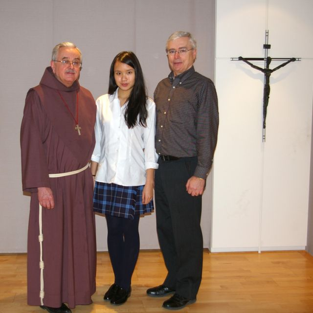 Fr. Damian MacPherson, left, stands with Friars' essay winner Natalie Wong and Jim O'Leary, publisher and editor of The Catholic Register.