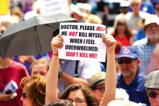 Sign sends a message at rally against assisted suicide in 2016 on Parliament Hill.