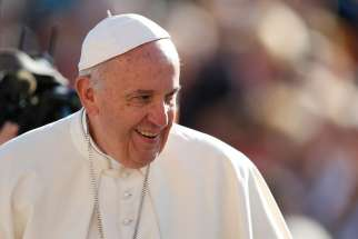 Pope Francis smiles during his general audience in St. Peter's Square at the Vatican Oct. 19.