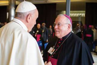 Pope Francis greets Archbishop Charles J. Chaput of Philadelphia before a session of the Synod of Bishops on young people, the faith and vocational discernment at the Vatican Oct. 16.