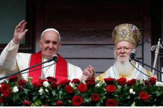Pope Francis and Ecumenical Patriarch Bartholomew of Constantinople greet a small crowd after delivering a blessing in Istanbul Nov. 30. 2014.