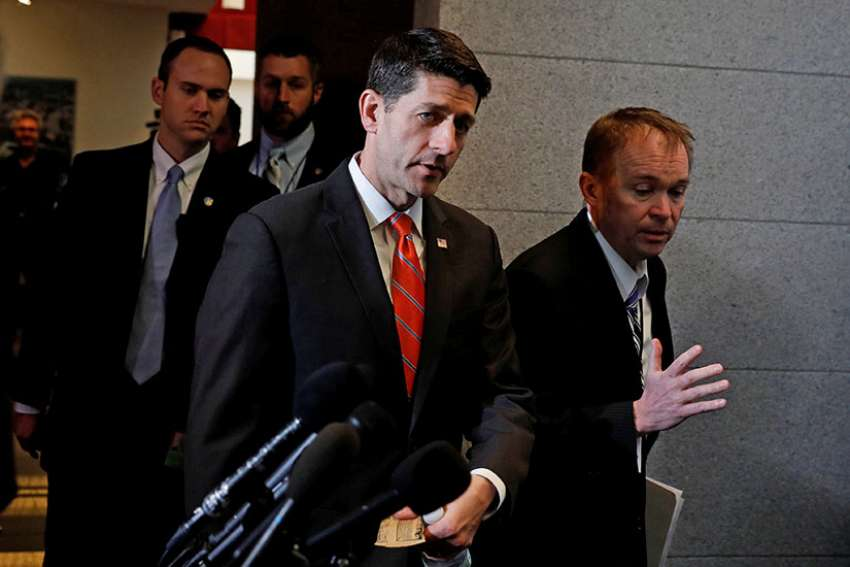 U.S. House Speaker Paul Ryan, R-Wis., and Mick Mulvaney, Office of Management and Budget director, arrive for a March 23 meeting about the American Health Care Act on Capitol Hill in Washington.
