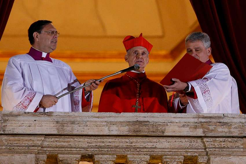 "French Cardinal Jean-Louis Tauran announces ""Habemus papam!"" (We have a pope!) from the central balcony of St. Peter's Basilica in 2013 at the Vatican. Cardinal Tauran, 75, died July 5 in the United States."