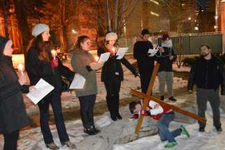 Students from three downtown university chaplaincies processed and re-enacted the Stations of the Cross on a cold winter day March 4.