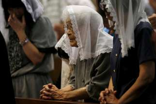 People pray for victims of the 1945 atomic bombing during an Aug. 9, 2015, Mass at the Urakami Cathedral in Nagasaki, Japan. Pope Francis will finally fulfill his desire to be a missionary to Japan when he visits the country, as well as Thailand, Nov. 20-26, 2019, the Vatican announced Sept. 13.