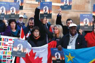 Clerical sex abuse victims and their supporters rally outside Castel Sant'Angelo in Rome Feb. 21.