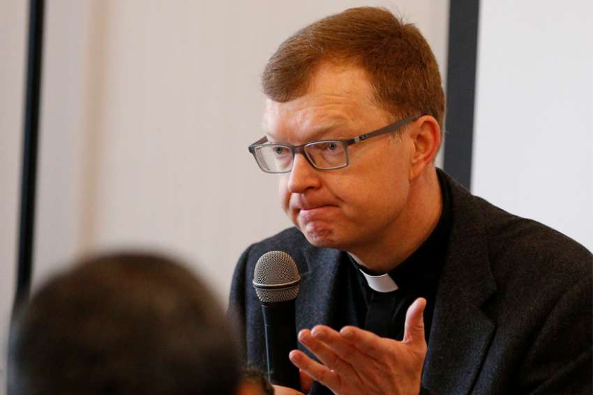 Jesuit Father Hans Zollner, a member of the Pontifical Commission for the Protection of Minors, is pictured in a 2019 file photo. The increased screen time and isolation because of quarantine measures or restrictions during the COVID-19 pandemic have put vulnerable minors at greater risk of grooming and abuse online, Father Zollner said.