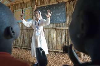 Sister Mariya Soosai, a member of the Daughters of Mary Immaculate, leads a group of children March 7 in an arithmetic class in a camp for internally displaced families inside a U.N. base in Juba, South Sudan. Some 34,000 people have sought protection at the base since violence broke out in December 2013.