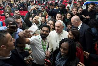 Pope Francis poses for a selfie during a pre-synod gathering of youth delegates at the Pontifical International Maria Mater Ecclesiae College in Rome March 19.