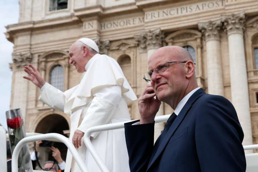 Domenico Giani, lead bodyguard for Pope Francis and head of the Vatican police force, keeps watch as the pope leaves his general audience in St. Peter's Square at the Vatican May 1, 2019. Pope Francis accepted the resignation of Giani Oct. 14, nearly two weeks after an internal security notice was leaked to the Italian press.