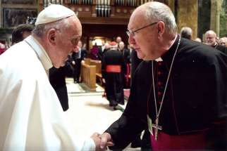 Pope Francis greets Bishop Kevin J. Farrell of Dallas in Washington in September 2015. Pope Francis has named the Texas bishop to head the Vatican's new office for laity, family and life.