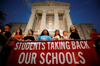 High school students hold candles in front of the North Carolina Capitol in Raleigh Feb. 20 in memory of the victims of the shooting at Marjory Stoneman Douglas High School in Parkland, Fla. The students were calling for safer gun laws after 17 people were killed when 19-year-old former student Nikolas Cruz stormed the Parkland school Feb. 14 with an AR-15 semi-automatic style weapon.