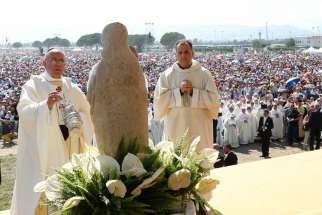 "Pope Francis uses incense as he celebrates a Mass attended by 250,000 people in Sibari, in Italy's Calabria region, June 21. During his homily, the pope said ""mafiosi"" are not in communion with God and are excommunicated. The Calabria region is home of t he 'Ndrangheta crime organization, known for drug trafficking."