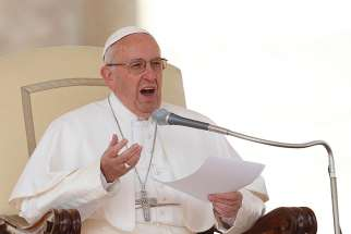 Pope Francis speaks during his general audience in St. Peter's Square at the Vatican March 16.