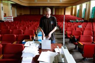 A worker at the election commission headquarters in Donetsk, Ukraine, arranges referendum materials May 8. Ukrainian Catholic bishops said the country's planned May 25 presidential election must proceed, despite violence designed to derail it.