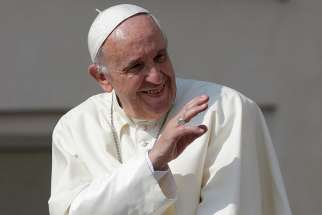 Pope Francis waves as he arrives for his general audience June 14 in St. Peter's Square at the Vatican.