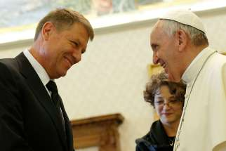 Pope Francis talks with Romanian President Klaus Iohannis during a private audience in the Apostolic Palace at the Vatican May 15.