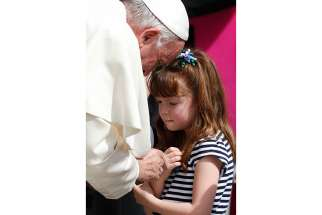 "Pope Francis greets Lizzy Myers of Mansfield, Ohio, during his general audience in St. Peter's Square at the Vatican April 6. Myers, who has a disease that is gradually rendering her blind and deaf, met the Pope as part of her ""visual bucket list."""