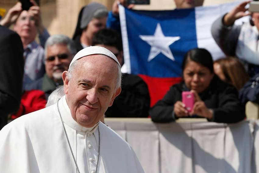 Chile's national flag is seen as Pope Francis leads his general audience in St. Peter's Square at the Vatican April 5. The Vatican announced the pope will visit Chile Jan. 15-18 and Peru Jan. 18-21.