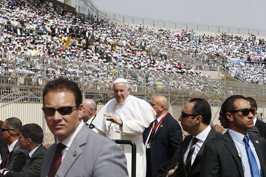 Pope Francis greets the crowd as he arrives to celebrate Mass at the Air Defense Stadium in Cairo April 29.