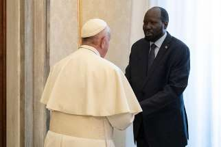 Pope Francis greets South Sudanese President Salva Kiir during a private audience at the Vatican March 16, 2019.