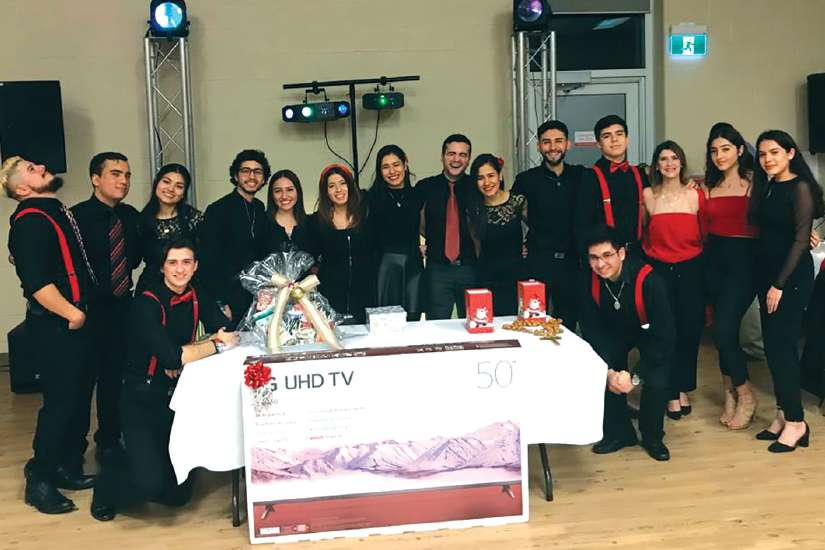 Young adult members of Toronto's Ita Gaudium organized a raffle during a dinner dance to raise enough money to go to World Youth Day in Panama City.