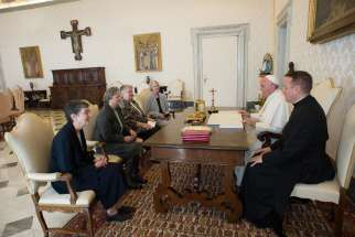 Pope Francis meets with representatives of the U.S. Leadership Conference of Women Religious in his library in the Apostolic Palace at the Vatican April 16. The same day the Vatican announced the conclusion of a seven-year process of investigation and di alogue with the group to ensure fidelity to church teachings. The outcome resulted in revised statues approved by the Vatican.
