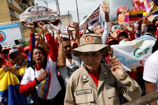 "Supporters of Venezuelan President Nicolas Maduro are seen in Caracas, Venezuela, Jan. 10 during his swearing-in ceremony. The Venezuelan bishops' conference has labeled his new government ""illegitimate"" and called for a ""change in government."""