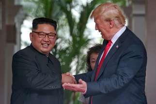 North Korean leader Kim Jong Un and U.S. President Donald Trump meet at the Capella Hotel on Sentosa island in Singapore June 12. Signing a joint statement, President Trump agreed to provide security guarantees to North Korea and Chairman Kim reaffirmed his commitment to the complete denuclearization of the Korean Peninsula.