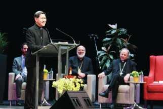 Cardinal Luis Antonio Tagle addresses 2,700 people at the Queen Elizabeth Theatre in Vancouver March 19. Among his audience was Ukrainian Bishop Ken Nowakowski, centre, and Archbishop J. Michael Miller.