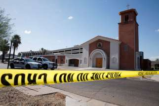Police tape and vehicles are seen outside Mater Misericordiae (Mother of Mercy) Mission in Phoenix the morning after a priest was killed and another critically injured during an attack at the mission the night of June 11. Sgt. Steve Martos of the Phoenix Police Department said police received a 911 call at about 9 p.m. reporting a burglary.