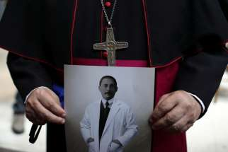 A photo of Jose Gregorio Hernandez Cisneros, a Venezuelan doctor born in 1864, is displayed following Mass in Caracas June 19, 2020. That day the Vatican announced Pope Francis had advanced the sainthood causes of the doctor, born in 1864, and four others.