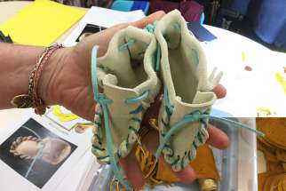 Grade 7 and 8 students from St. Norbert and St. Andrew Catholic Schools made 70 pairs of baby moccasins last year while learning about Indigenous culture.