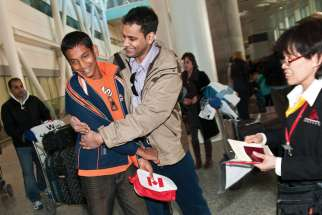 Scenes such as these of refugees arriving at Toronto's Pearson Airport have disappeared as COVID-19 took hold. Plans to take in 1.2 million immigrants by 2023 has refugee sponsors wondering how that number can be achieved with travel restrictions brought on by COVID-19.