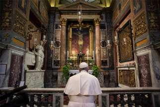 "Pope Francis prays in front of a crucifix at the Church of St. Marcellus in Rome March 15, 2020. The crucifix was carried through Rome in 1522 during the ""Great Plague."" The pope prayed as coronavirus deaths in Italy peaked at 368 in a 24-hour period, bringing the total number of deaths to 1,809 out of 24,747 cases."