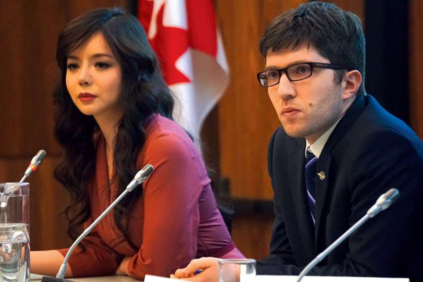 Miss World Canada 2015, actress and human rights activist Anastasia Lin, and Conservative MP Garnett Genuis at an April 3 Parliamentary forum on religious freedom.