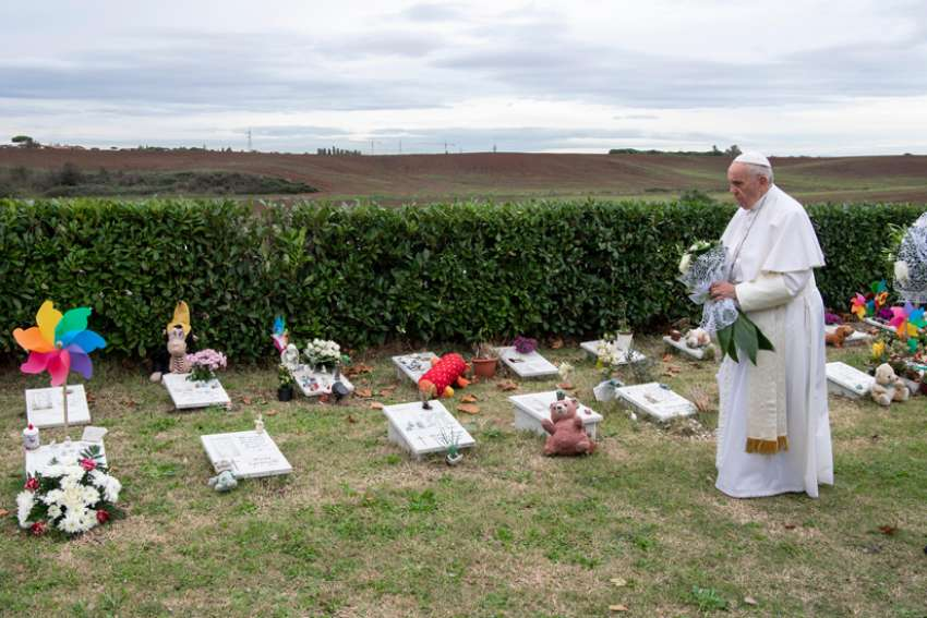 Pope Francis visits graves of children before celebrating Mass marking the feast of All Souls at Laurentino Cemetery in Rome Nov. 2, 2018.