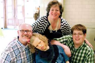 Catholic author Mary Lenaburg is pictured here with husband Jerry, son Jonathan and daughter Courtney, who battled gand mal seizures her whole life and died in 2014.