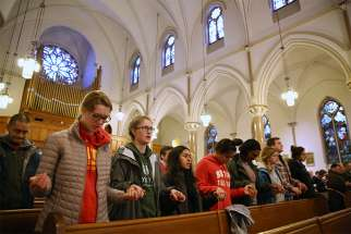 Students from Elizabeth Seton High School in Bladensburg, Md., pray during a March 24 Mass at St. Patrick Catholic Church in Washington. The Mass, sponsored by Catholic Charities of the Archdiocese of Washington, was celebrated to give students an opportunity to pray before participating in the March for Our Lives.
