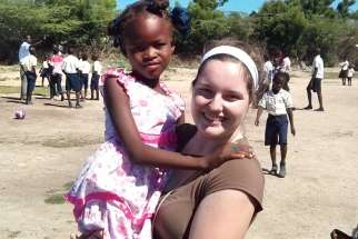 Caitlin Curtis in DeRac, Haiti with her sponsored child, seven-year-old Djanesca. The dress Djanesca is wearing was given to her by Caitlin.