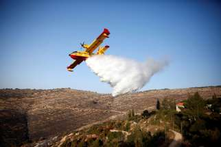 A plane drops fire retardant during a wildfire near Nataf, Israel, Nov. 26.