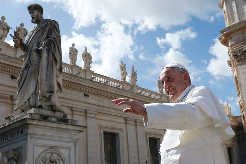 The statue of St. Peter is seen as Pope Francis leaves his general audience in St. Peter's Square at the Vatican March 14.