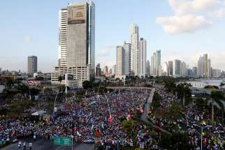 Pilgrims gather along the Cinta Costera area of Panama City during the opening Mass of World Youth Day Jan. 22, 2019.