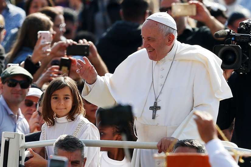 Children ride in the popemobile as Pope Francis greets the crowd during his general audience in St. Peter's Square at the Vatican May 22, 2019.