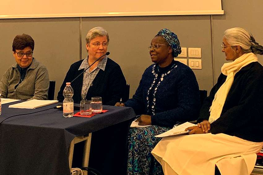 Women religious from around the world are seen at a Rome briefing following their participation in the Vatican summit on protection of minors. Pictured at the Feb. 25, 2019, event are Maltese Sister Carmen Sammut, head of the International Union of Superiors General; German Holy Spirit Sister Maria Hornamann; Sister Veronica Openibo, congregational leader of the Society of the Holy Child Jesus; and Indian Sister Monica Joseph, superior general of the Congregation of Religious of Jesus and Mary.