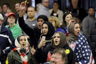 Young Muslims protest Republican presidential candidate Donald Trump before being escorted out during a campaign rally in the Kansas Republican Caucus at the Century II Convention and Entertainment Center in Wichita, Kan., on March 5, 2016.