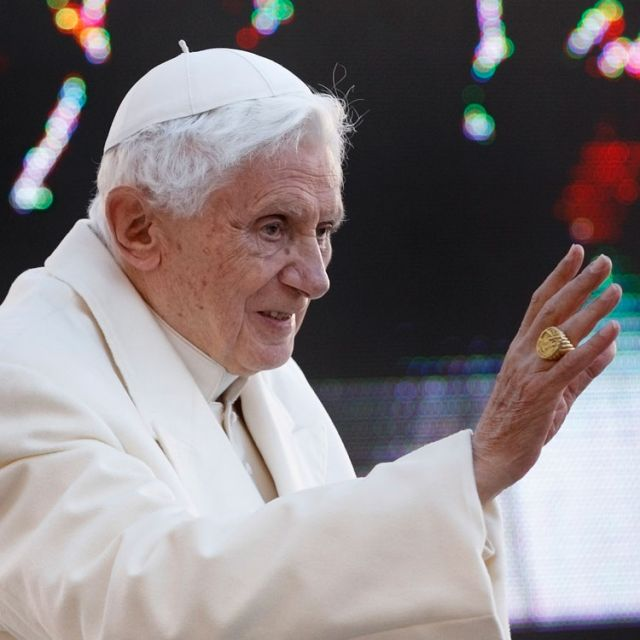 Pope Benedict XVI waves as he arrives to lead his final general audience in St. Peter's Square at the Vatican Feb. 27.