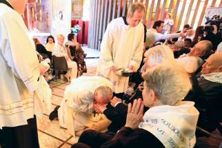 Pope Francis kisses the foot of a disabled person at Our Lady of Providence Centre during Holy Thursday Mass in Rome last year.